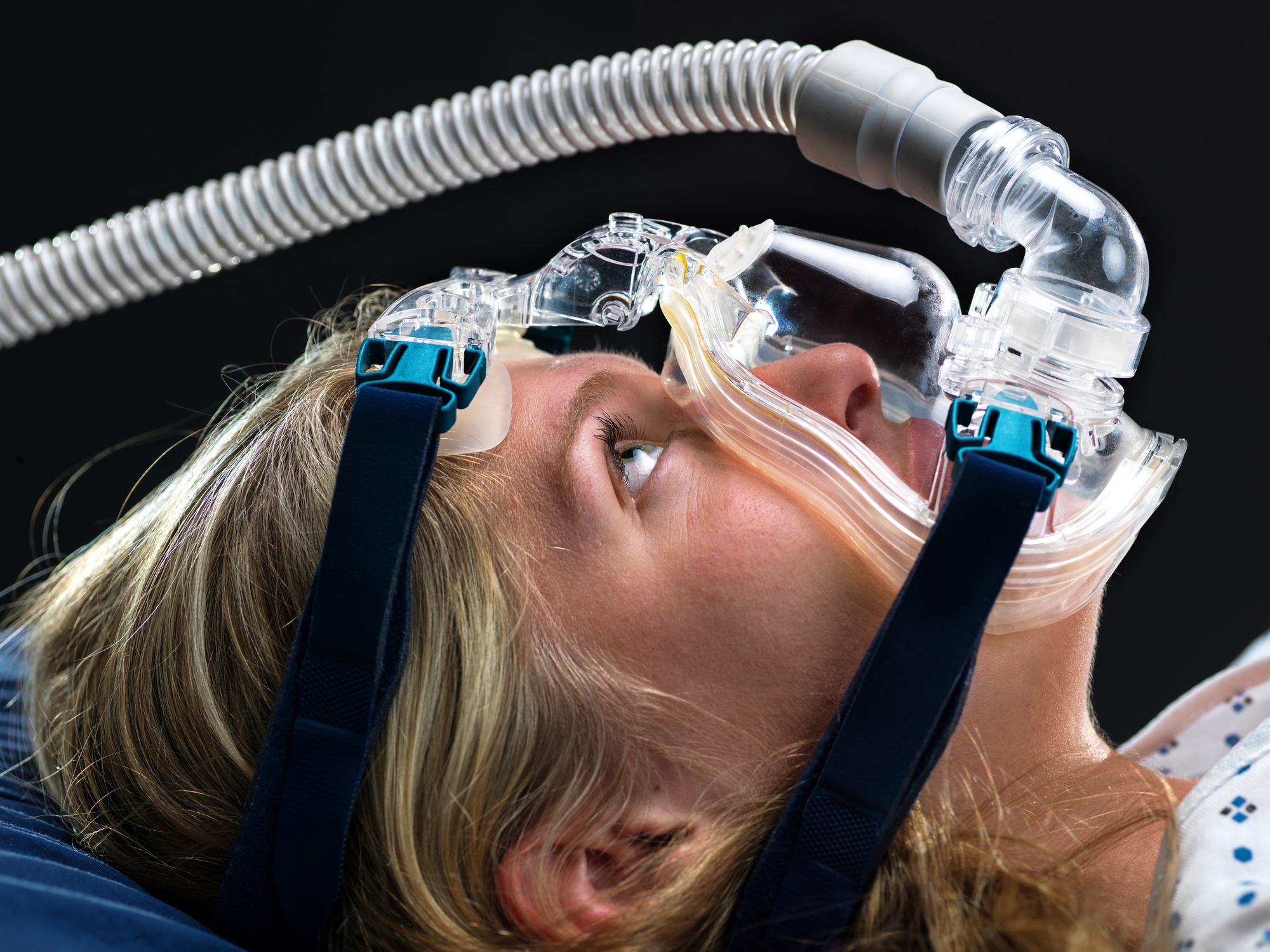 A woman wearing a CPAP mask
