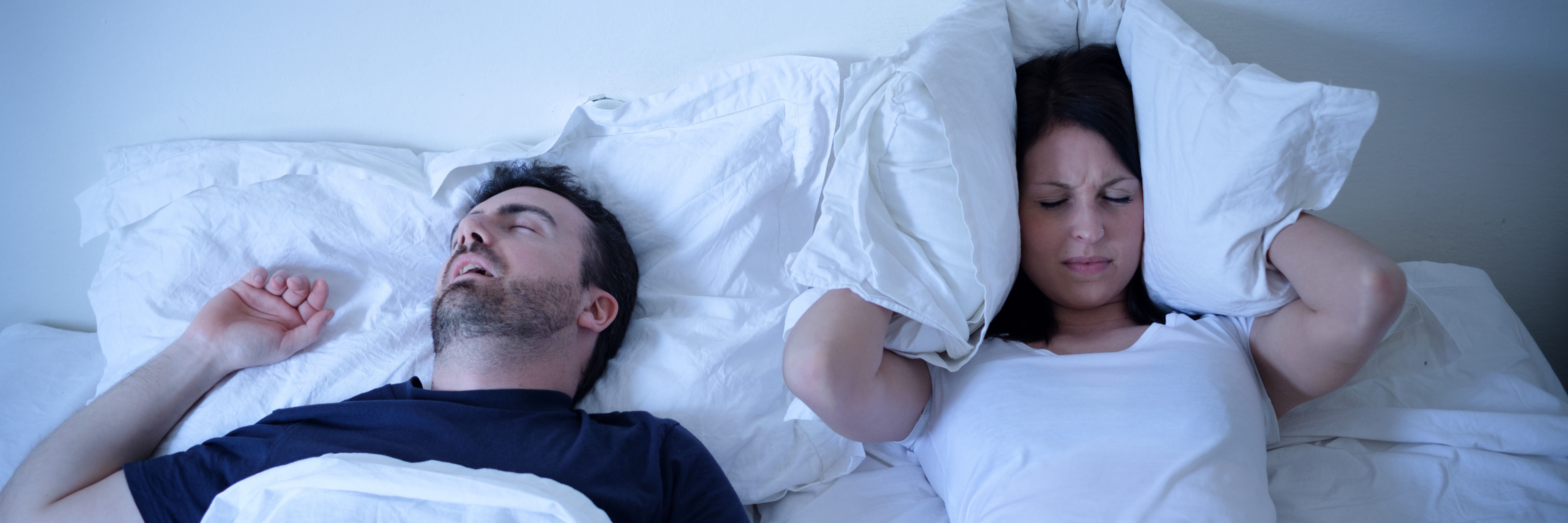 Couple in bed while wife struggles to sleep