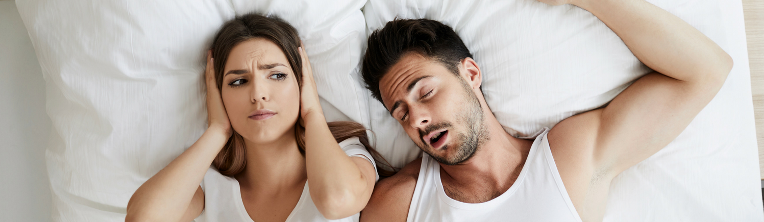 A couple struggling with sleep apnea